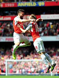 Olivier Giroud of Arsenal celebrates his goal with Nacho Monreal of Arsenal - Mandatory by-line: Dougie Allward/JMP - 15/05/2016 - FOOTBALL - Emirates Stadium - London, England - Arsenal v Aston Villa - Barclays Premier League