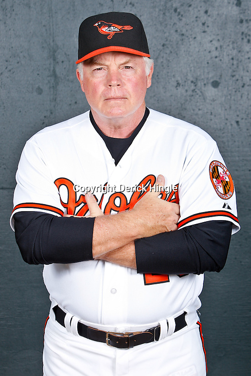 February 26, 2011; Sarasota, FL, USA; Baltimore Orioles manager Buck Showalter (26) poses during photo day at Ed Smith Stadium.  Mandatory Credit: Derick E. Hingle