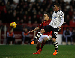 Ross McCormack of Fulham (R) and David Vaughan of Nottingham Forest in action - Mandatory byline: Jack Phillips / JMP - 07966386802 - 5/12/2015 - FOOTBALL - The City Ground - Nottingham, Nottinghamshire - Nottingham Forest v Fulham - Sky Bet Championship