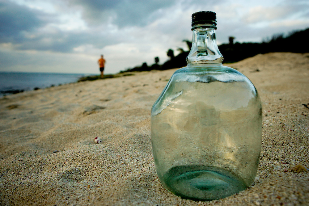 A bottle on the beach in Tulum, Riviera Maya, Mexico. © 2007 Scott Morgan