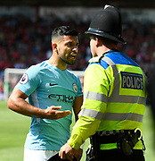 Sergio Aguero (10) of Manchester City confronts a police officer who was keeping him away from the celebrating crowd after Raheem Sterling (7) of Manchester City winning goalduring the Premier League match between Bournemouth and Manchester City at the Vitality Stadium, Bournemouth, England on 26 August 2017. Photo by Graham Hunt.