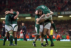 Ireland players celebrate at the final whistle after securing the Grand Slam.RBS 6 Nations 2009, Wales v Ireland.Millennium Stadium, 21.03.09