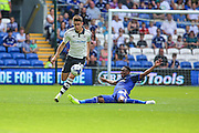 Kagisho Dikgacoi makes a lunge at Tom Cairney  during the Sky Bet Championship match between Cardiff City and Fulham at the Cardiff City Stadium, Cardiff, Wales on 8 August 2015. Photo by Shane Healey.