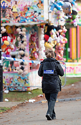 © Licensed to London News Pictures. 04/11/2018. Woking, UK. A police forensics photographer works next to a deflated slide in Woking Park after it collapsed injuring eight children. The park was holding a fireworks party when the accident happened. Photo credit: Peter Macdiarmid/LNP