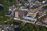 Nederland, Friesland, Leeuwarden, 08-09-2009; toren Oldehove met links Provinciale bibliohee en Rijksarchief, rechts  Stadskantoor in de voorgrond..Overview of the city with the tower Oldehove and Stadskantoot (city hall)  in the foreground.luchtfoto (toeslag); aerial photo (additional fee required); .foto Siebe Swart / photo Siebe Swart