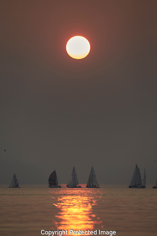 Red sun sets behind the former city hall building in Tacoma, WA, Wednesday, Aug. 9, 2017. The sun is red due to forest fire smoke drifting in from British Columbia. (Photo/John Froschauer)