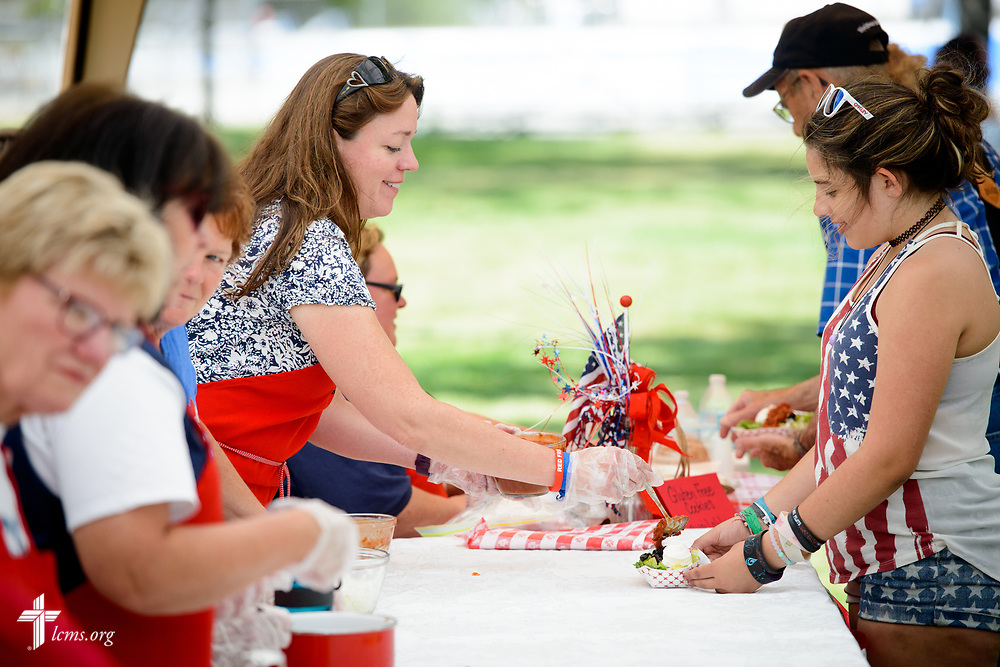 Dawn Turpin, a member at Trinity Lutheran Church, Grangeville, Idaho, works with fellow volunteers in the church's walking tacos tent at the Grangeville Border Days Independence Day celebration and parade on Tuesday, July 4, 2017, in Grangeville. LCMS Communications/Erik M. Lunsford