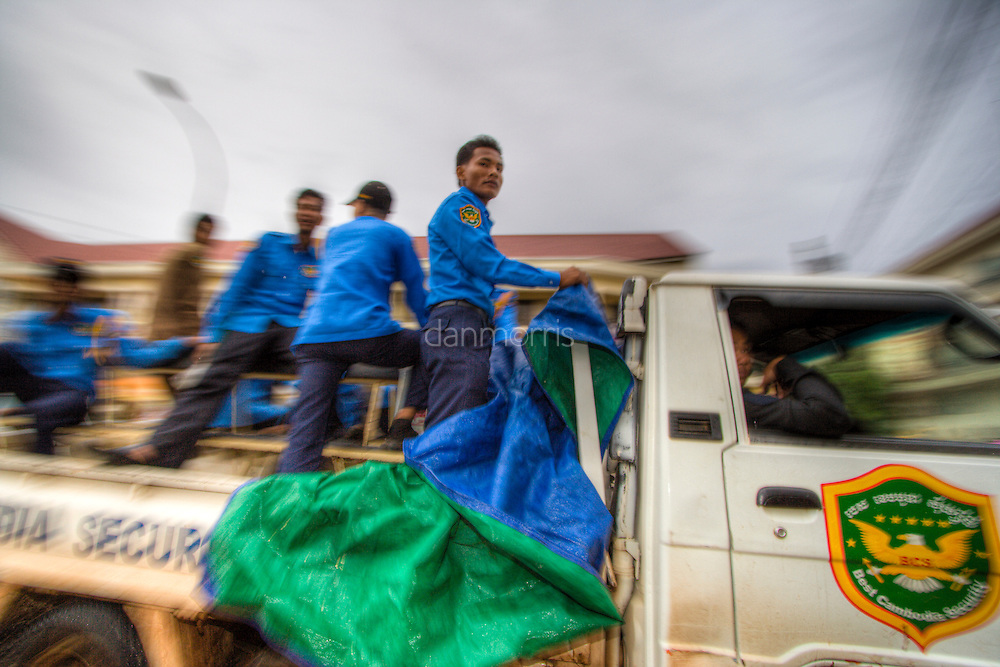 Security workers commute to work in Siem Riep, Cambodia