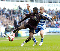 Photo: Leigh Quinnell.<br /> Reading v Portsmouth. The Barclays Premiership. 17/03/2007. Portsmouths Arnold Mvuemba holds off Readings James Harper.