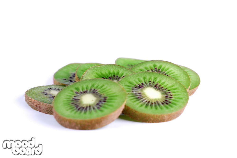 Slices of kiwi on white background