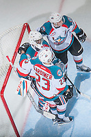 KELOWNA, CANADA - FEBRUARY 1: Reid Gardiner #23 and Gordie Ballhorn #4 congratulate Michael Herringer #30 of the Kelowna Rockets on the win against the Calgary Hitmen on February 1, 2017 at Prospera Place in Kelowna, British Columbia, Canada.  (Photo by Marissa Baecker/Shoot the Breeze)  *** Local Caption ***