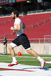 Oct 8, 2011; Stanford CA, USA;  Stanford Cardinal quarterback Andrew Luck (12) warms up before the game against the Colorado Buffaloes at Stanford Stadium.  Stanford defeated Colorado 48-7. Mandatory Credit: Jason O. Watson-US PRESSWIRE