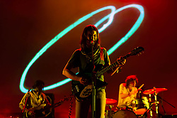 © Licensed to London News Pictures. 25/06/2013. London, UK.   Tame Impala performing live at Hammersmith Apollo.  In this pic - Cam Avery (left), Kevin Parker (centre), Julien Barbagallo (right). Tame Impala is a psychedelic rock band from Perth, Australia, composed of band members Kevin Parker (vocals, guitar), Dominic Simper (guitar/synth), Cam Avery (bass)  and Julien Barbagallo (drums).   Photo credit : Richard Isaac/LNP