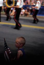 Americana young boy waves american flag