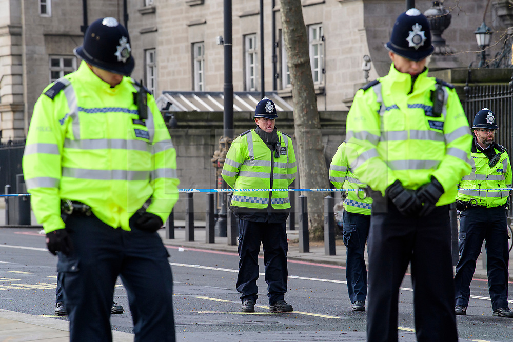 © Licensed to London News Pictures. 23/03/2017. London, UK. Police officers observe a minutes silence outside New Scotland Yards, just meters away from where a lone terrorist killed 4 people and injured several more, in an attack using a car and a knife. The attacker managed to gain entry to the grounds of the Houses of Parliament, killing one police officer. Photo credit: Ben Cawthra/LNP