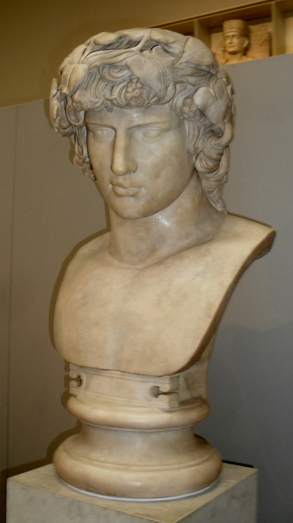 Marble bust of Antinous.  Made in Rome AD130-38.  From the Janiculum, Rome, Italy.  Antinous, Hadrian's lover, was Greek from Bithynia (northern Turkey). He met Hadrian in the 120's and joined his court.  In AD 130 Antinous drowned in the River Nile in Egypt and Hadrian mourned him openly and he was worshipped as a god.  Statues show him as the Egyptian Osiris or, as here, the Greek Dionysus.