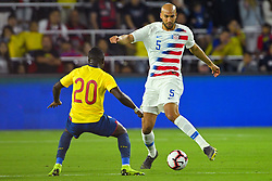 March 21, 2019 - Orlando, Florida, USA - US defender John Brooks (5) and Ecuador midfielder Jhegson Mendez (20) go for a ball during an international friendly between the US and Ecuador at Orlando City Stadium on March 21, 2019 in Orlando, Florida. .The US won the game 1-0...©2019 Scott A. Miller. (Credit Image: © Scott A. Miller/ZUMA Wire)