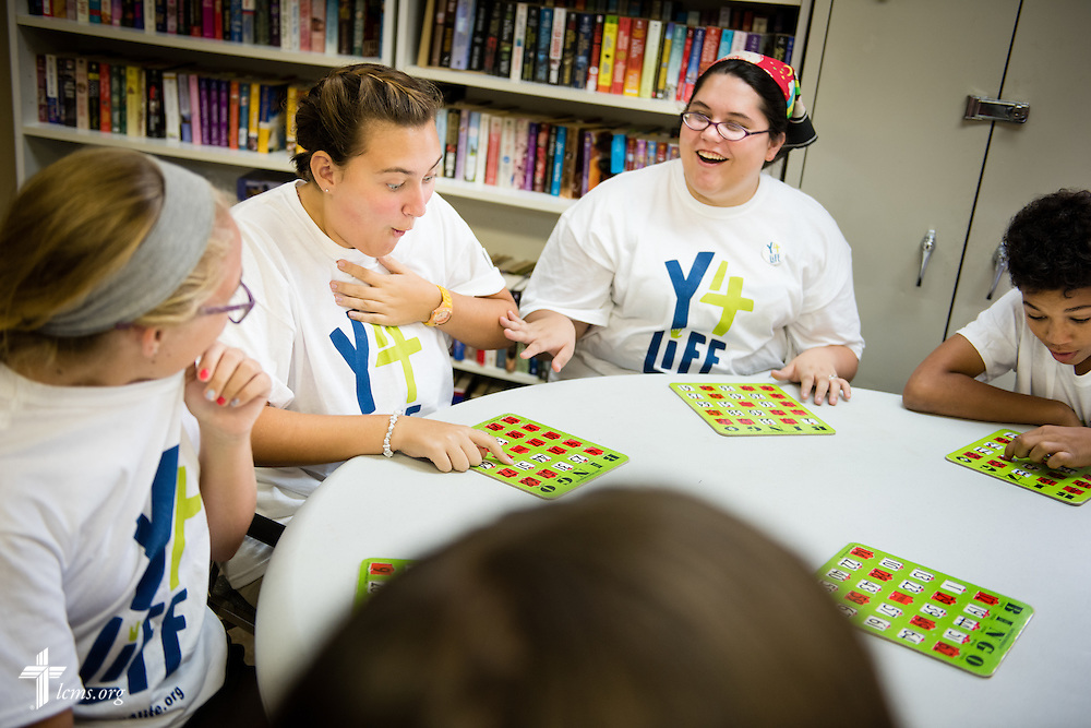 "Y4Life student volunteers Georgiana ""Maddie"" McLoren (center, left), Morgan Sims (left), and Andrea ""Andy"" Stone share a lighthearted moment with other Y4Life student volunteers as they play bingo with elderly adults during a servant event on Saturday, Sept. 12, 2015, in Sanford, Fla. LCMS Communications/Erik M. Lunsford"
