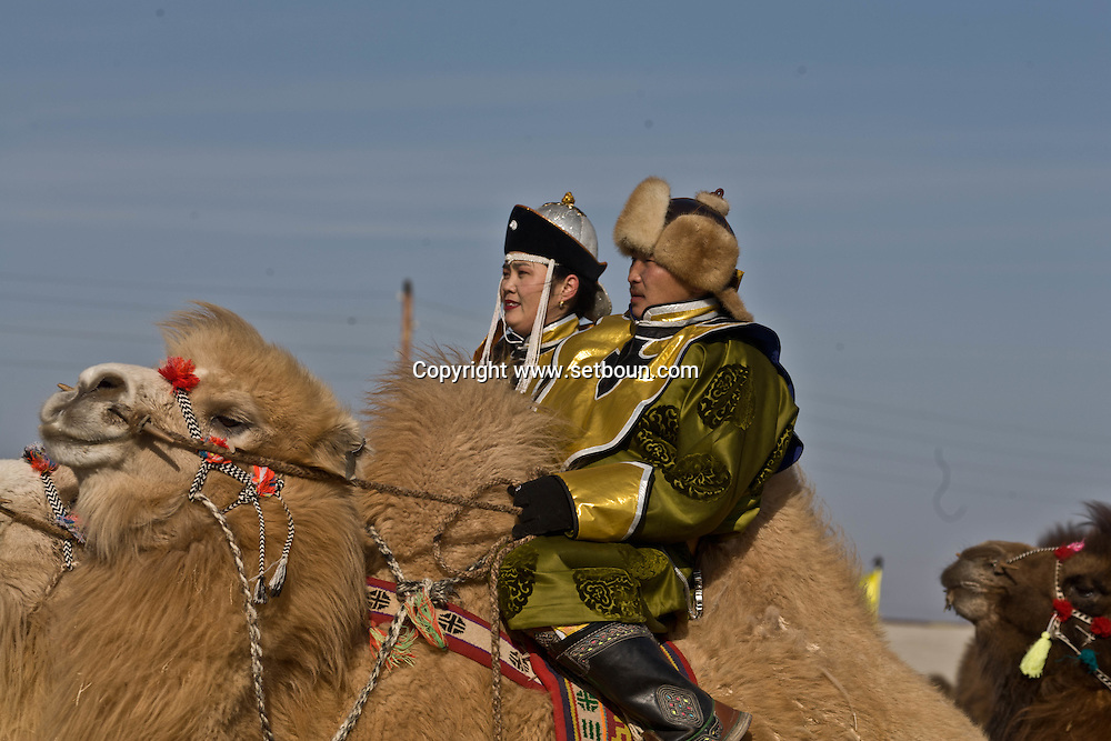 Mongolia. camel festival. Gobi desert.. in Winter for Tsagan sar , the mongol new year  Bulgan -