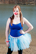 Megan Fitzgerald poses for a portrait in her costume before the Ohio University Polar Plunge. Fitzgerald was an entrant in the Polar Plunge costume contest, which was held before the plunge itself. Photo by: Ross Brinkerhoff.