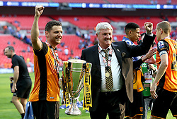Hull City Manager Steve Bruce and his son Alex Bruce of Hull City celebrate their team winning the Playoff Final and Promotion to The Premier League - Mandatory by-line: Robbie Stephenson/JMP - 28/05/2016 - FOOTBALL - Wembley Stadium - London, England - Hull City v Sheffield Wednesday - Sky Bet Championship Play-off Final