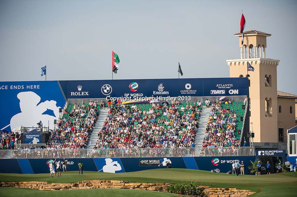 Martin Kaymer and Lee Westwood finish off their respective rounds in front of the grandstand at the 18th hole during the second round of the DP World Tour Championship held at the Jumeirah Golf Estates in Dubai, United Arab Emirates, on Friday, November 15, 2013.  Photo by: Stephen Hindley/SPORTDXB