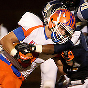 Randleman's Bradley Berridge is tackled by North Brunswick's DeShawn Montgomery. (Jason A. Frizzelle)