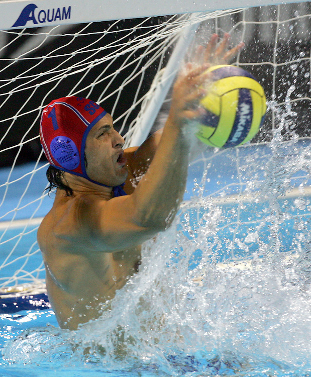Serbia and Montenegro's goalkeeper Denis Sefik makes a save against Croatia during their men's water polo semi-final match  at the FINA World Championships in Montreal, Canada Thursday 28 July, 2005.  Serbia and Montenegro defeated Croatia 5-4.