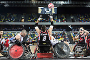 UNITED KINGDOM, London: 2015 World Wheelchair Rugby Challenge. Caption: Canada's Michael Whitehead (centre) reaches for the ball to score a try in the World Wheelchair Rugby Championship Finals between Canada and USA. Rick Findler / Story Picture Agency