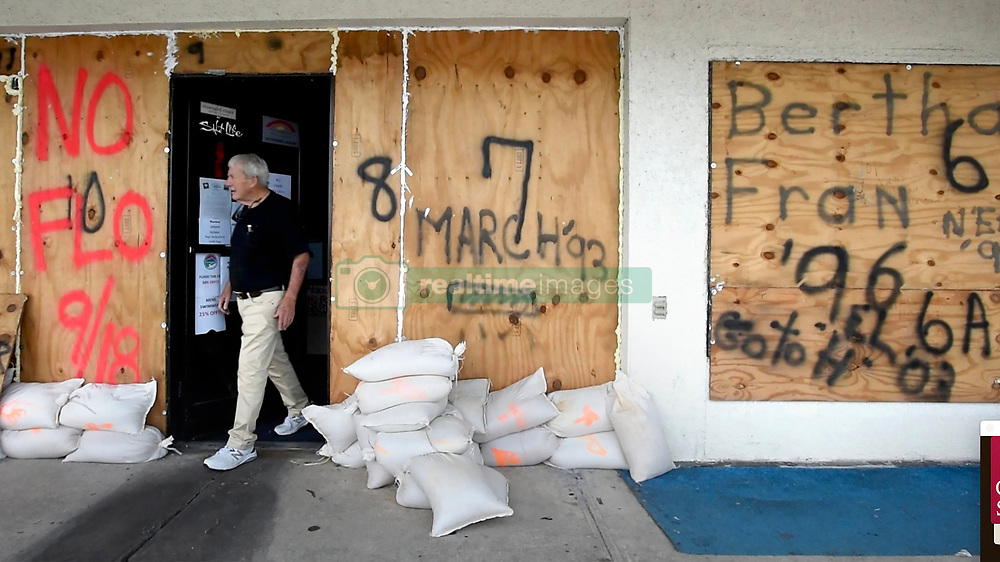 """Gordon D. Reddick of Wrightsville Beach, NC, USA, walks out of his store as he prepares for Hurricane Florence on Wednesday, September 12, 2018. """"You think you're gonna hide? Better stay where you'd feel safe,"""" Reddick said. Photo by Chuck Liddy/Raleigh News & Observer/TNS/ABACAPRESS.COM"""