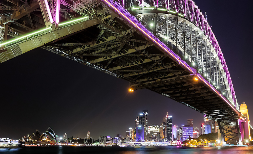 Wide angle view of the Sydney Harbour Bridge and Sydney's CBD at night during the annual Vivid Lighting Festival, Australia