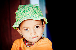 Portrait of a soulful burmese child in Kalaw, Myanmar, Asia