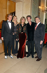 Left to right, MR & MRS BEN SANGSTER, MR & MRS GUY SANGSTER and MR NICK MORRIS at 'A Rout' an evening of late evening party, essentially of revellers in aid of the Great Ormond Street Hospital Children's Charity and held at Claridge's, Brook Street, London W1 on 25th January 2005.<br />