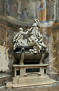 Funerary Monument of Monseigneur Haffreingue, 1785-1871, designed by Dutoit and sculpted by Cela and Eugene Delaplanche, 1836-91, in the third apse chapel of the Basilique Notre-Dame-de-l'Immaculee-Conception or Basilica of Notre-Dame de Boulogne, a Roman Catholic cathedral built 1827-63 in Neoclassical style by Benoit-Agathon Haffreingue, in Boulogne, Pas de Calais, France. The sculpture depicts Haffreingue kneeling and presenting a model of the church to the Virgin. The cathedral is listed as a national monument. Picture by Manuel Cohen