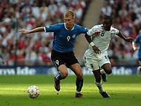 Photo: Tony Oudot.<br /> England v Estonia. UEFA European Championships Qualifying. 13/10/2007.<br /> Ragnar Klavan of Estonia with Shaun Wright Phillips of England