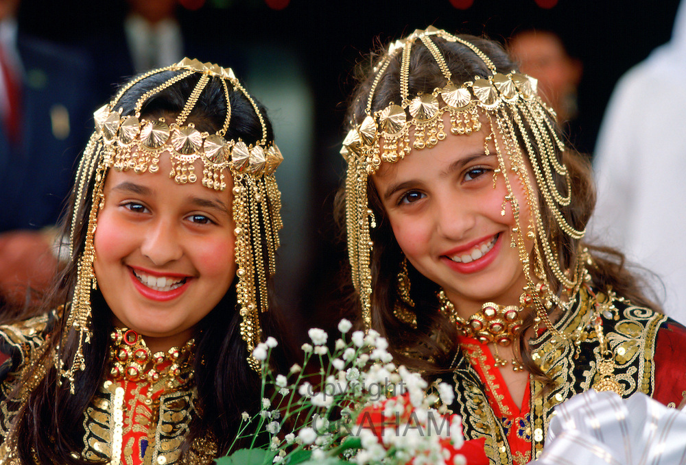 Pretty young girls dressed for a wedding festival in Kuwait City, Kuwait RESERVED USE - NOT FOR DOWNLOAD -  FOR USE CONTACT TIM GRAHAM
