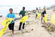 Youth participate the the beach clean up organized by Southern Durban Community Environmental Alliance (SCDEA)/KZN, 1 December 2011