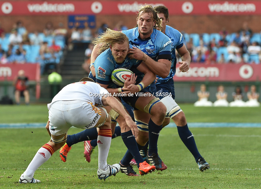 PRETORIA, South Africa, 29 MARCH 2014 : Dewald Potgieter with the support of Jacques du Plessis of the Bulls leads the charge with Michael Fitzgerald of the Chiefs making the tackle during the Vodacom Super Rugby match between the VODACOM BULLS and the CHIEFS at Loftus Versfeld in Pretoria, South Africa on 29 MARCH 2014. The game ended in a 34 all draw.<br /> <br /> &copy; Anton de Villiers / SASPA