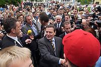 12 MAY 2004, LUDWIGSFELDE/GERMANY:<br /> Gerhard Schroeder, SPD, Bundeskanzler, schuettelt - umgeben von Personenschuetzern des BKA - Schuelern die Hand, waehrend einem spontanen Rundgang ueber den Schulhof, Besuch der Gesamtschule Ludwigsfelde<br /> Gerhard Schroeder, Federal Chancellor, is visiting a school near Berlin<br /> IMAGE: 20040512-02-021<br /> KEYWORDS: Gerhard Schröder, Schule, Schüler, pupil, pupils, Personenschützer, BKA