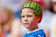 A young Tranmere Rovers fan, with a melon on his head, in support of club manager Tranmere Rovers manager Micky Mellon (not in picture) during the EFL Sky Bet League 2 Play Off Final match between Newport County and Tranmere Rovers at Wembley Stadium, London, England on 25 May 2019.
