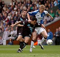 Photo. Glyn Thomas, Digitalsport.<br /> Blackburn Rovers v Leicester City. <br /> FA Barclaycard Premiership. 17/04/2004.<br /> Blackburn's John Stead (R) battles for the ball with Nikos Dabizas.