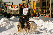 3/3/2007:  Anchorage Alaska -  Veteran Melanie Gould of Talkeetna, AK fly down the street during the Ceremonial Start of the 35th Iditarod Sled Dog Race