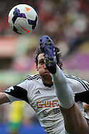 Swansea city's Michu in action. Barclays premier league match , Swansea city v Norwich city at the Liberty stadium in Swansea, South Wales on Saturday 29th March 2014.<br /> pic by Andrew Orchard,  Andrew Orchard sports photography.