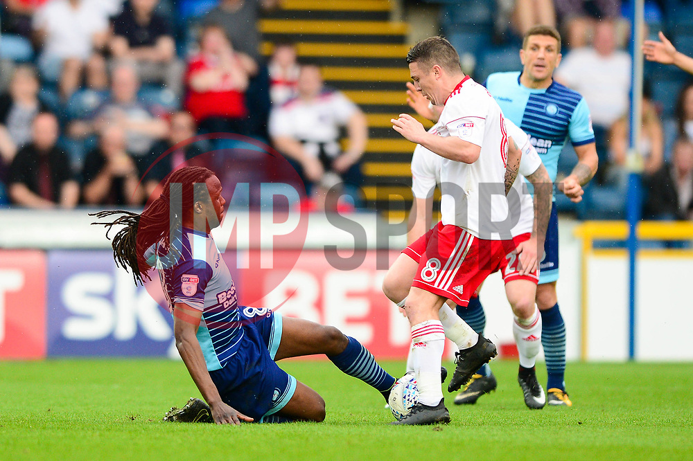 Marcus Bean of Wycombe Wanderers challenges Scott Brown of Accrington Stanley - Mandatory by-line: Dougie Allward/JMP - 21/04/2018 - FOOTBALL - Adam's Park - High Wycombe, England - Wycombe Wanderers v Accrington Stanley - Sky Bet League Two