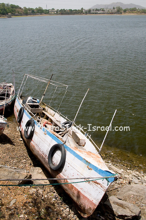 India, Rajasthan, Udaipur, Fateh Sagar lake fishing boat moored on shore