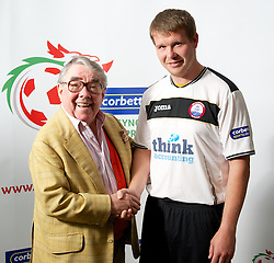 CARDIFF, WALES - Tuesday, August 14, 2012: Gap Connah's Quay's Craig Jones with Ronnie Corbett, the sporting ambassador ot Corbett Sport, at the launch the 2012/2013 Welsh Premier League at the St. David's Hotel. (Pic by David Rawcliffe/Propaganda)
