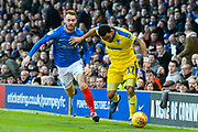 Andy Barcham (17) of AFC Wimbledon on the attack chased by Tom Naylor (7) of Portsmouth during the EFL Sky Bet League 1 match between Portsmouth and AFC Wimbledon at Fratton Park, Portsmouth, England on 1 January 2019.