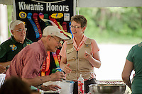 Robin Jacobs serves dessert to Gerard Chaloux following the 70th Anniversary celebration of the Kiwanis Pool in St. Johnsbury Vermont.  Karen Bobotas / for Kiwanis International