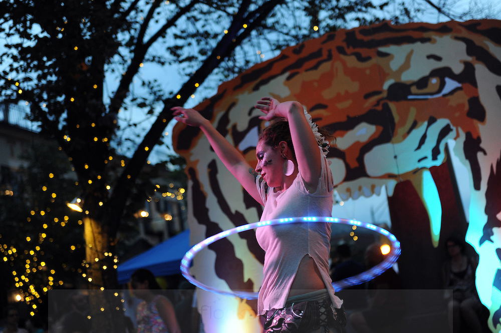 Kitty MacGettigean, of Jamaica Plain, performs with the Boston Hoop Troop during Somerville's Ignite Festival in Union Square, Saturday, Aug. 15, 2015.<br /> Published 8/19/15