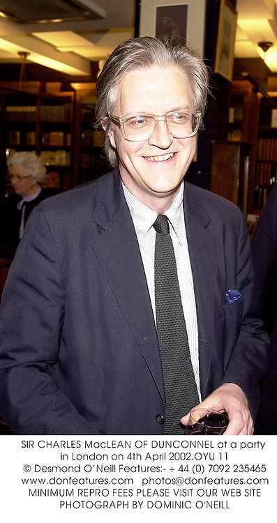 SIR CHARLES MacLEAN OF DUNCONNEL at a party in London on 4th April 2002.OYU 11